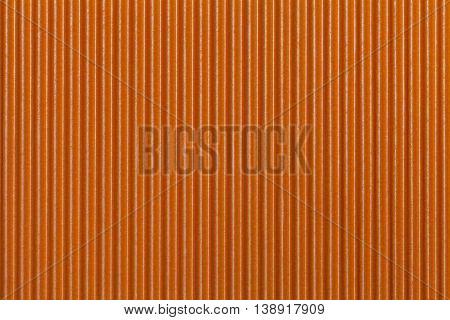 Texture corrugated orange paper. Striped corrugated background closeup
