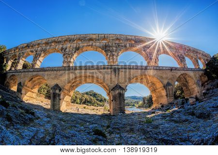 Pont Du Gard Against Sunset Is An Old Roman Aqueduct In Provence, France
