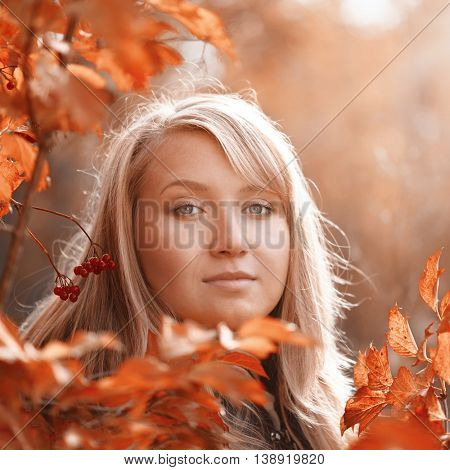 Portrait of woman at autumn