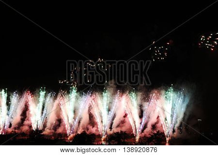 Colorful celebration fireworks on sky. International Fireworks. Fireworks display on dark sky background.
