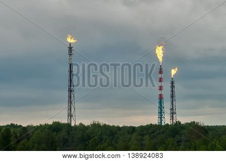Tobolsk, Russia - July 15. 2016: Sibur company. Torches for burning of associated gas of Petrochemical Industrial Complex