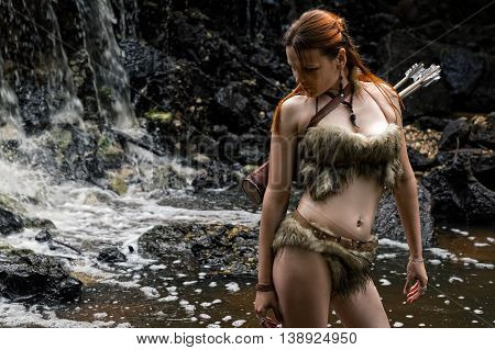 female hunter with a quiver in the forest