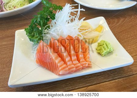 Raw salmon slide seafood sashimi set on table