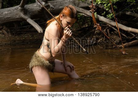 archer hunting in water arrow outdoors on river