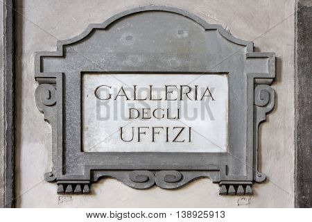Galleria degli Uffizi, Uffizi Gallery, street plate on a wall of museum in Florence, region of Tuscany, Italy