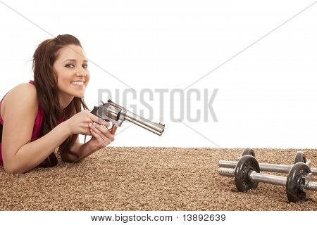 Woman Pointing Gun At Weights Smile