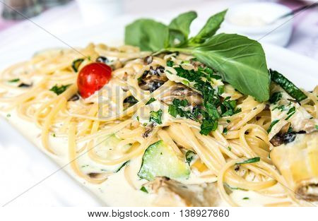 Spaghetti with aubergine and tomato on a the table