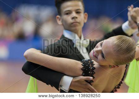 Minsk Belarus -May 28 2016: Shkinderov Vladislav and Belisova Polina Perform Juvenile-1 Standard European Program on National Championship of the Republic of Belarus in May 28 2016 in Minsk Republic of Belarus