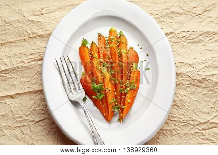 Plate of sliced baby carrot with herbs, top view