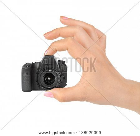 Hand and small camera isolated on white background