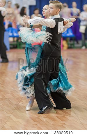 Minsk Belarus -May 28 2016: Bazhnichin Egor and Borisevich Yuliya Perform Juvenile-1 Standard European Program on National Championship of the Republic of Belarus in May 28 2016 in Minsk Republic of Belarus