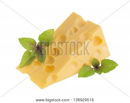 Piece of cheese with basil leaves isolated on white
