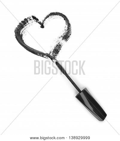 Stroke of black mascara in the form of heart with applicator brushisolated on white background