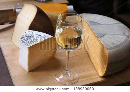 Fresh cheese with wine on the table in cellar