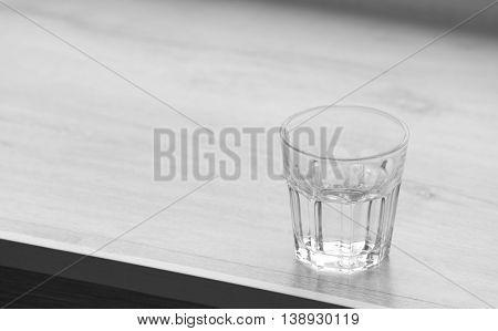 Glass of pure water on windowsill