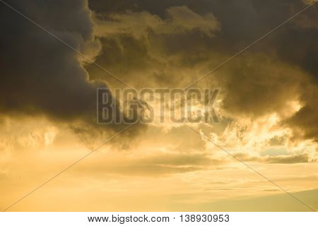 Background Of Golden Storm Clouds At Sunset.