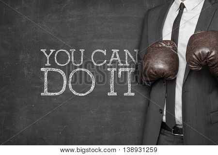 You can do it on blackboard with businessman wearing boxing gloves