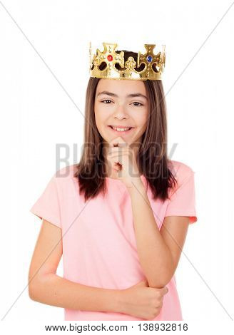 Pensive preteen girl with a crown isolated on a white background