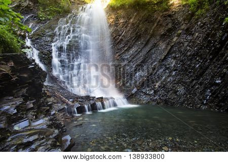 Waterfall in deep moss forest clean adn fresh in Carpathians Ukraine.