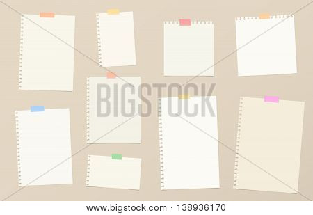 Pieces of brown cutout notebook paper are stuck with colorful sticky tape on background.