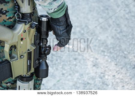 soldier with guns and the cigarette in her hand close-up