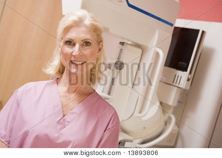 Portrait Of A Nurse In Front Of A Mammogram Machine