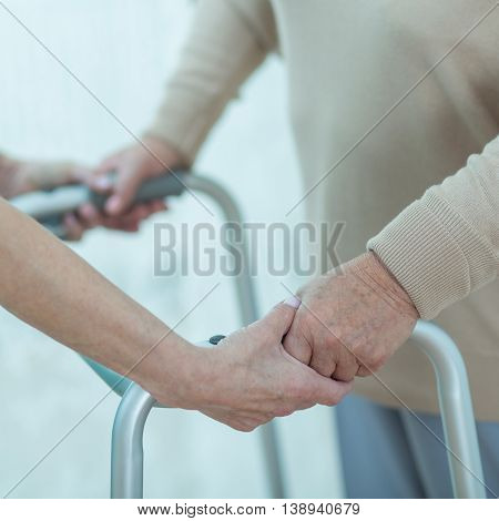 Nurse Helping Disabled Elderly Lady