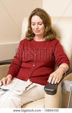 Patient Reading Magazine While Being Given Chemotherapy