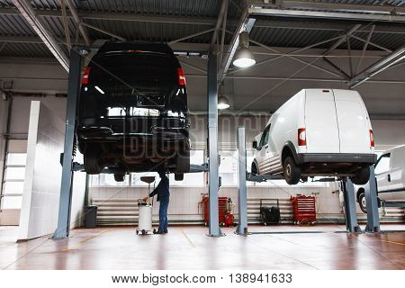 Auto service maintenance for minibuses, modern workshop for car repairing