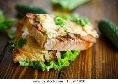 toast baked with sausage, cheese and cucumber with lettuce