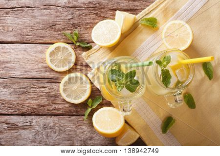 Refreshing Lemonade With Ice Cubes And Mint Close Up. Horizontal Top View