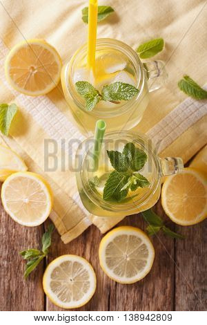 Refreshing Lemonade With Ice Cubes And Mint Close Up. Vertical Top View