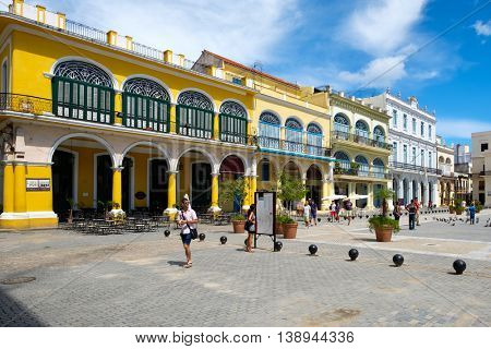 HAVANA,CUBA - JULY 17,2016 :  Tourists and locals at a colorful square on Old Havana