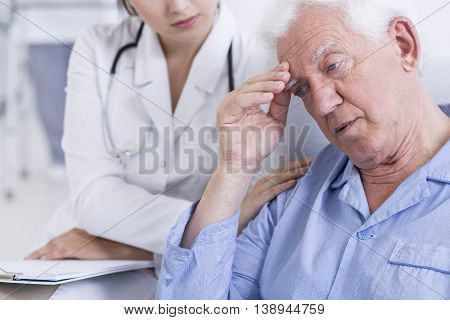 Shot of a worried elder man receiving bad news