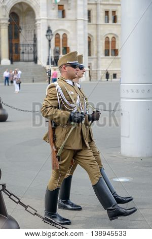 BUDAPEST, HUNGARY - MAY 29, The Hungarian soldier guarding the Hungarian Parliament building on 29 May 2016, Budapest, Hungary.