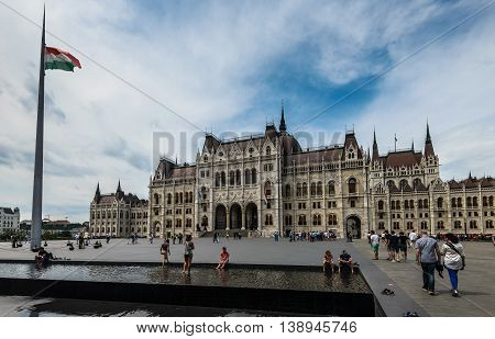 BUDAPEST, HUNGARY - MAY 29, Unidentified people on the front of Hungarian Parliament building on 29 May 2016, Budapest, Hungary.
