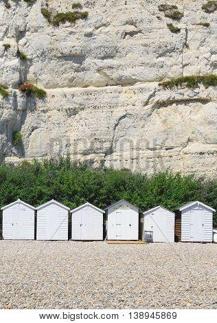 White beach huts on Jurassic Coast in Beer Devon