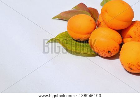Pile of fresh apricots isolated on white
