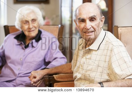 Senior couple relaxing in armchairs