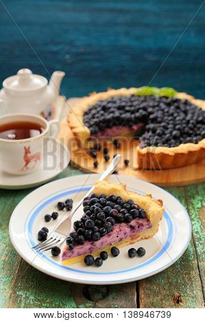 Homemade tart with cottage cheese mousse and fresh organic forest blueberries vertical