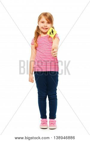Picture of positive seven years old girl holding Warning Children Crossing road sign miniature, isolated on white