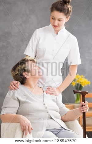 Senior Lady And Helpful Caregiver