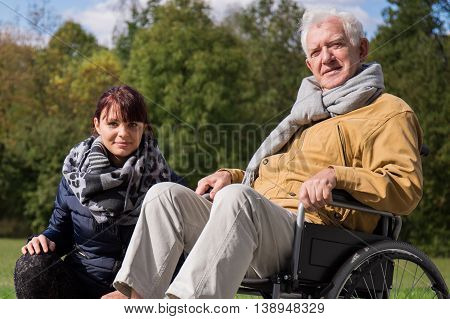 Caregiver And Positive Elderly Man