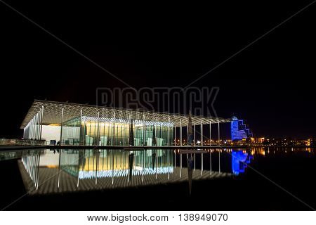 MANAMA, BAHRAIN - APRIL 21, 2016: The beautiful National Theatre well lit in the night.