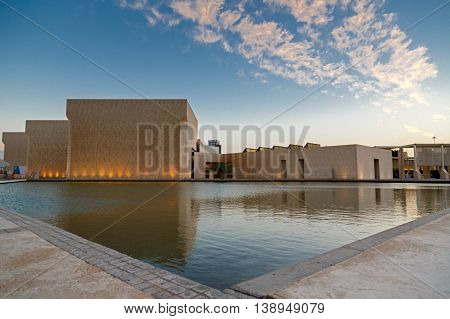 MANAMA, BAHRAIN - APRIL 17, 2016: The beautiful National Museum partially lit during the evening