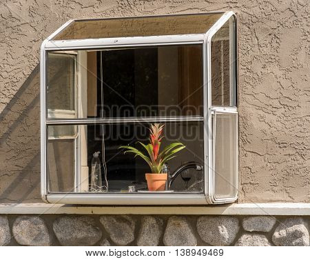 Garden Bay Kitchen Window With Flower Behind The Glass