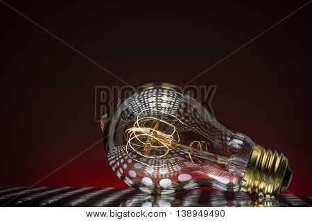 Light Bulb Concept Lit bulb with Red Background