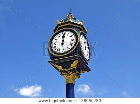 Big clock in Bearwood , Birmingham, on sunny day .  Big clock on the blue sky in United Kingdom