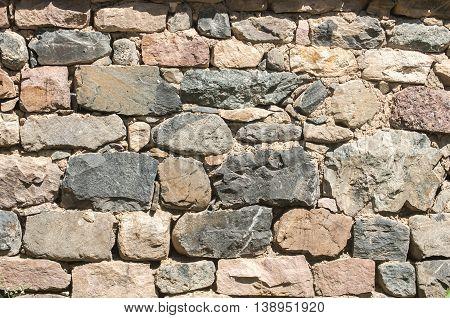 Masonry house stone wall closeup as background