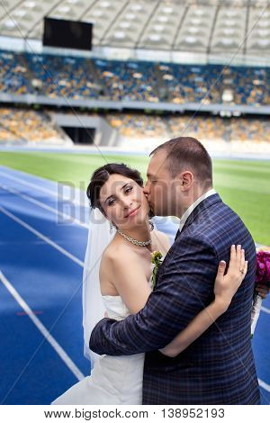 Newlyweds at the stadium on your wedding day